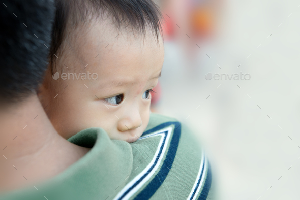 Asian baby boy with his father - Stock Photo - Images