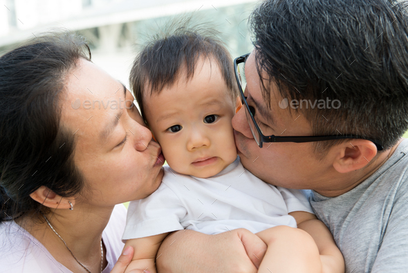 Young Asian Chinese family outdoor - Stock Photo - Images