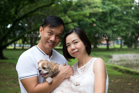Asian lovely couple with shih tzu dog - Stock Photo - Images
