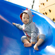 Small Asian baby boy playing slide - PhotoDune Item for Sale