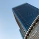 Skyscraper against blue sky - PhotoDune Item for Sale