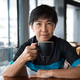 Senior Asian woman with coffee in cycling jersey - PhotoDune Item for Sale