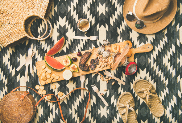 Picnic concept with sausage, fruit, cheese, pate and straw accessories - Stock Photo - Images