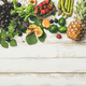 Flat-lay of seasonal fruit, vegetables and greens over wooden background - PhotoDune Item for Sale