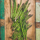 Raw uncooked green asparagus over rustic wooden tray background - PhotoDune Item for Sale