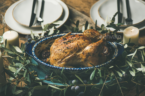 Whole roasted chicken decorated with olive tree branch, selective focus - Stock Photo - Images
