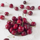 ripe cherries on white board painted with chalk - PhotoDune Item for Sale