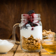 jug with berries cerealas  and yogurt on wood - PhotoDune Item for Sale
