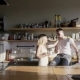 A Happy Couple Is Drinking Coffee in the Kitchen, Laughing and Smiling - VideoHive Item for Sale