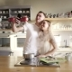 A Nice Young Couple Is Enjoying Sunny Morning in the Kitchen, Taking Selfies, Hugging and Cooking - VideoHive Item for Sale