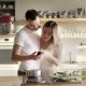 The Happy Smiling Lovers Are Checking Their Smartphone and Laughing While Cooking in the Sunny - VideoHive Item for Sale