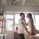 A Loving Happy Couple Is Kissing and Hugging in the Sunny Kitchen - VideoHive Item for Sale
