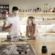 A Happy Smiling European Couple Is Cooking and Tasting Soup in the Kitchen - VideoHive Item for Sale