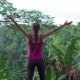 Woman in Sports Wear Raise Arms Up in the Air Looking on Jungle - VideoHive Item for Sale