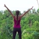 Woman in Sports Wear Raise Hands Looking on Jungle - VideoHive Item for Sale