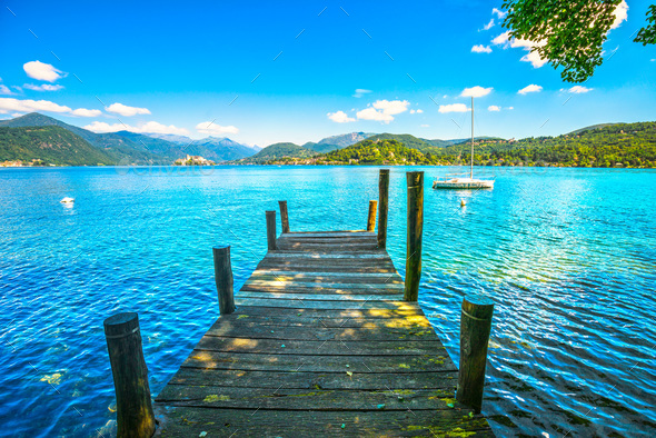 Orta Lake landscape. Wooden pier or jetty and Orta San Giulio vi - Stock Photo - Images