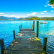 Orta Lake landscape. Wooden pier or jetty and Orta San Giulio vi - PhotoDune Item for Sale