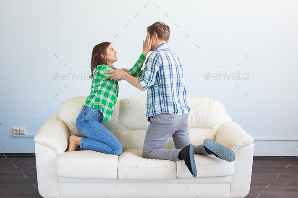 Woman victim of domestic violence and abuse. Violent young man threatening his girlfriend - Stock Photo - Images