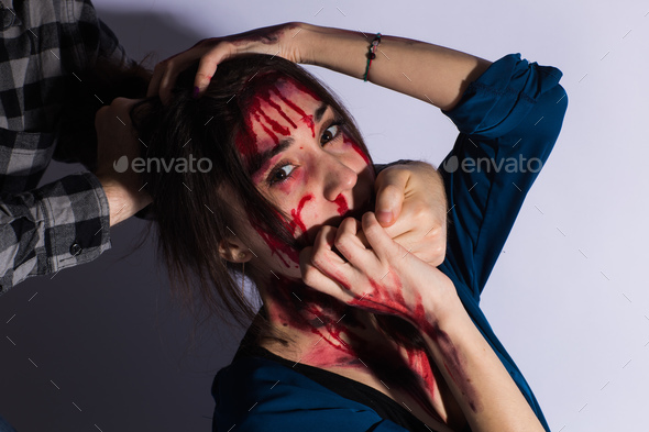 Sexual abuse with a man attacking to a scared woman in a dark place. - Stock Photo - Images