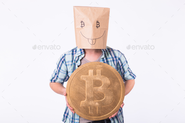 Golden Bitcoin in a funny man hand, Digitall symbol of a new virtual currency. - Stock Photo - Images