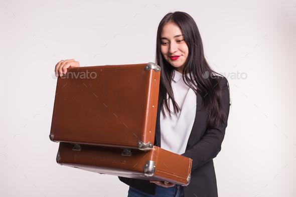 Beautiful asian girl with red lips staring into retro suitcase. - Stock Photo - Images