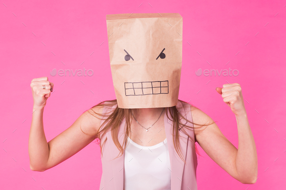 Concept of negative emotions - Angry woman with a paper bag on his face. - Stock Photo - Images