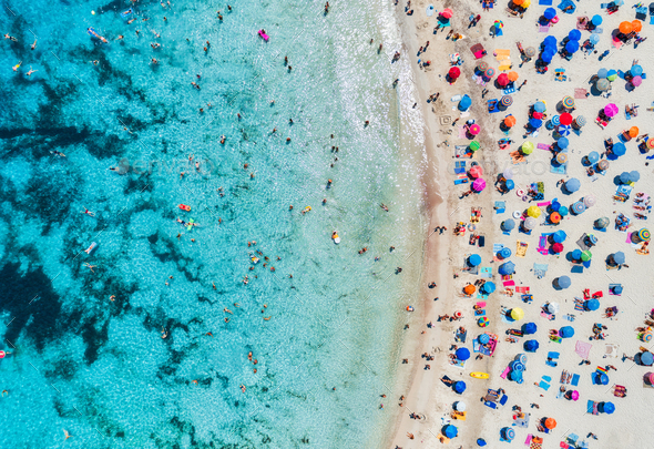 Aerial view of sandy beach with umbrellas and sea - Stock Photo - Images