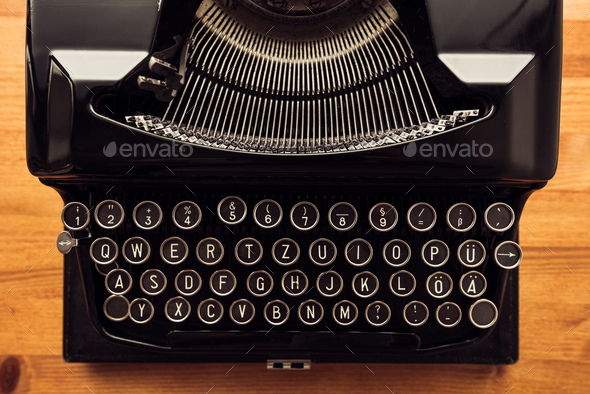 Vintage typewriter machine on writers desk - Stock Photo - Images