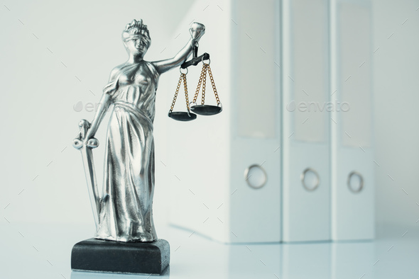 Lady Justice statue in law firm office - Stock Photo - Images