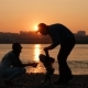 of a Young Family Walking By the River at Sunset - VideoHive Item for Sale