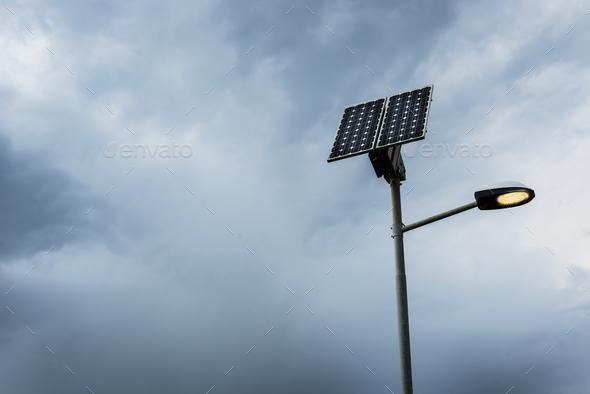 Solar panel on street lamp post - Stock Photo - Images