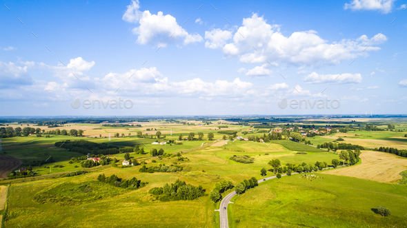 Aerial view of a country road between agricultural fields - Stock Photo - Images