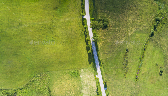 Aerial view of a country road between agricultural fields in Europe Germany - Stock Photo - Images