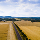 Aerial view of a country road with cars between agricultural fields in Europe - PhotoDune Item for Sale