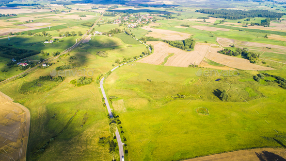 Aerial view of a road with cars between agricultural fields - Stock Photo - Images