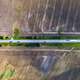 Aerial view of a road with cars between agricultural fields - PhotoDune Item for Sale