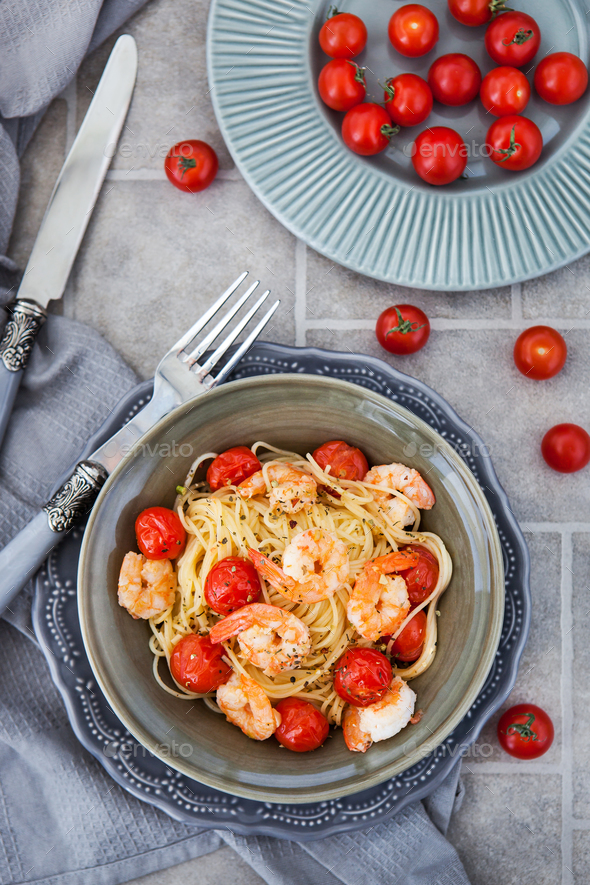 Spaghetti with prawns and cherry tomatoes, top view - Stock Photo - Images