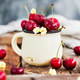 Fresh ripe cherries in a mug on rustic background - PhotoDune Item for Sale