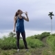 Sporty Woman Drink Water During Jogging in Nature Park - VideoHive Item for Sale