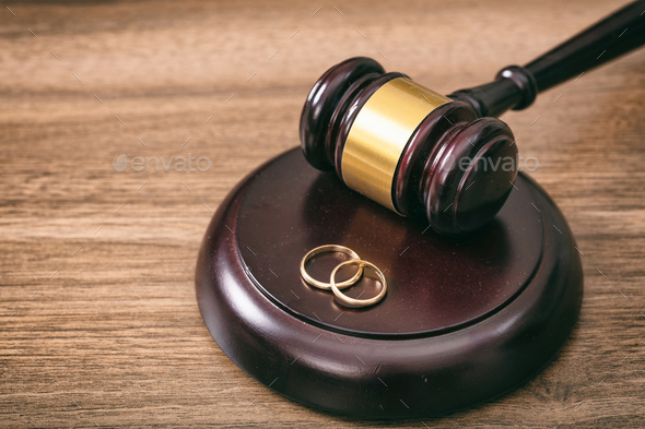 Wedding rings and judge gavel on wooden background, copy space - Stock Photo - Images