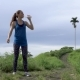 Woman Drink Water During Running on Road in Nature Park. Fitness Concept - VideoHive Item for Sale