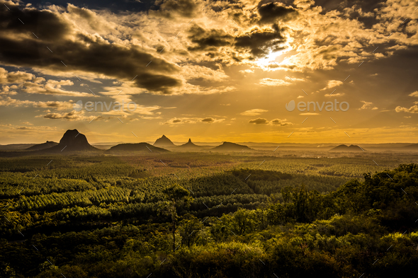 Panoramic view of Glass House Mountains at sunset visible from W - Stock Photo - Images