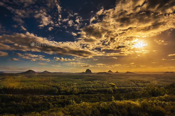 View of Glass House Mountains at sunset visible from Wild Horse - Stock Photo - Images