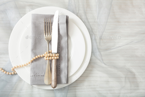 Wedding table place setting with plates, fork and knife, top view - Stock Photo - Images