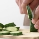 Cook's Hands Cut a Fresh Cucumber on a Board in - VideoHive Item for Sale