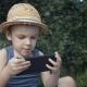 Young Boy Playing Video Games on His Smartphone - VideoHive Item for Sale