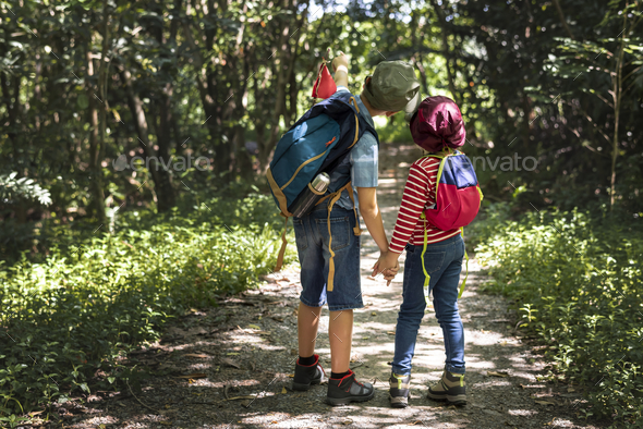 Sister and brother on an adventure - Stock Photo - Images