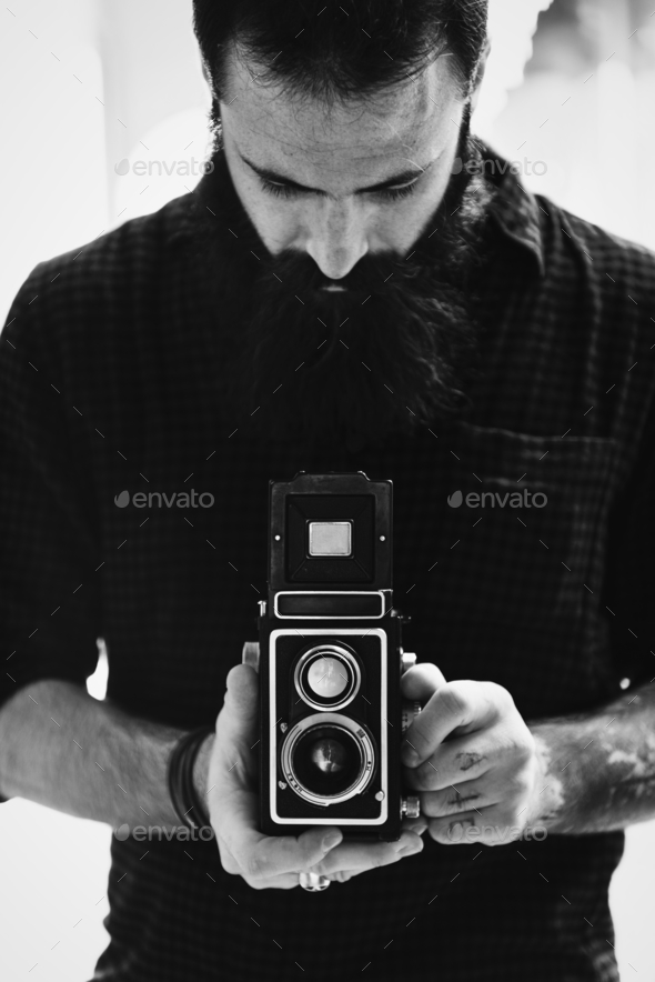 Photographer using a vintage camera - Stock Photo - Images