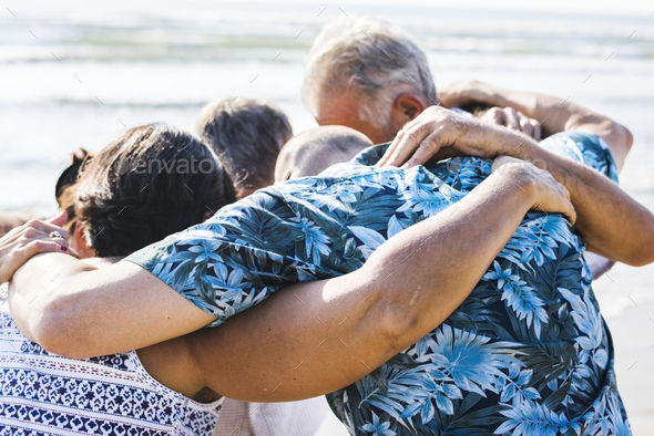Senior friends playing at the beach - Stock Photo - Images