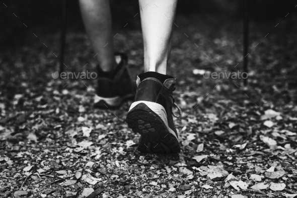 Close-up image of woman wearing trekking shoes - Stock Photo - Images